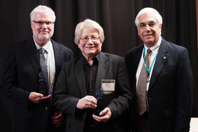 Last year's winners with (on far right) Eric Smith, MAPB Board President : (L-R) Robert Barclay Volunteer CMU Public Broadcasting Network (Mt Pleasant), Barry Baker Former General Manager, Delta College Quality Public Broadcasting (University Center)