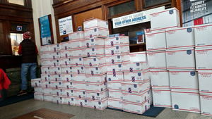 """Treasures for Troops"" await shipping at the Ionia Post Office"